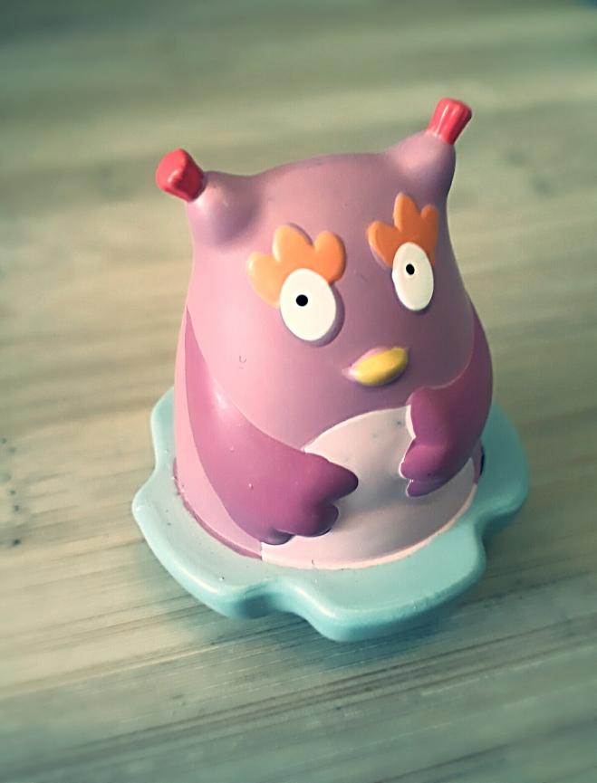 small pink plastic owl