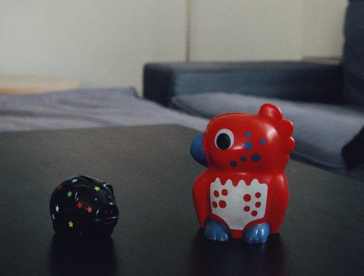 two piggy banks in different designs on a table
