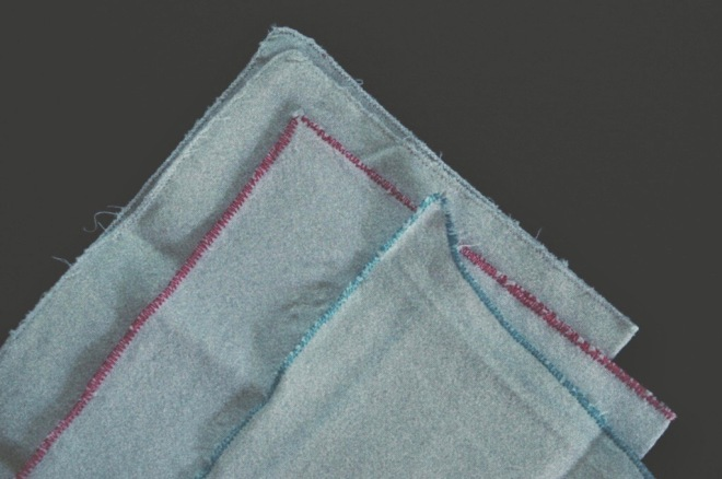 close up of some home made handkerchiefs showing the bad stitching