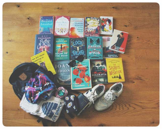 Books, shoes, a backpack, shirts, and several other items lying on the ground