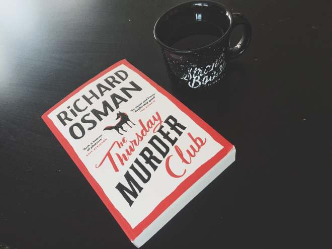 book and a cup of tea on a table flatlay photography