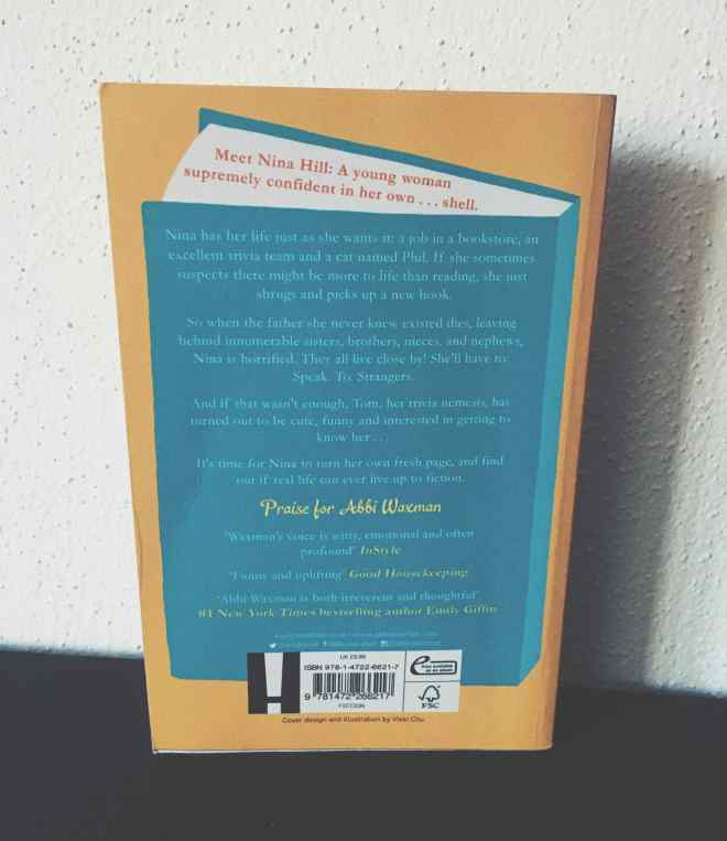 Back cover of the Nina Hill book on a shelf