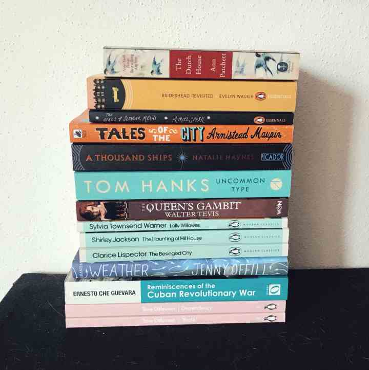 a pile of books on a shelf